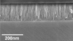 Negative oxygen ion impingement on SiO2 thin films during growth
